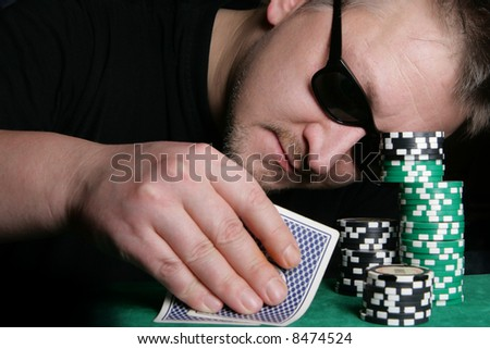 Poker gambler and casino chips close-up