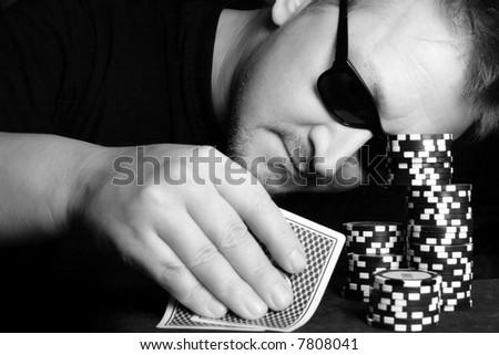 Poker gambler close-up. Black and white image.