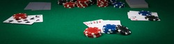 poker game concept on green table, long photo