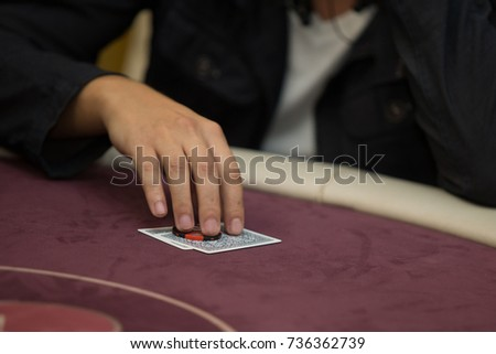 Poker game - dealing cards. Man's hands dealing cards and chips. Close up #736362739
