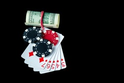 Poker game with straight flush combination and money. Chips and cards on the black table. Winnings in poker