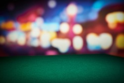 Poker green table in casino with blur background