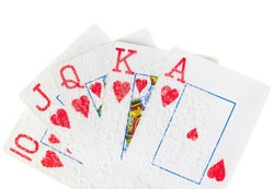 Poker hand. A royal flush playing cards hand in hearts taken underwater.