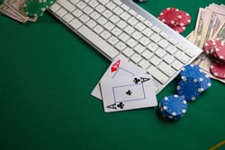 Poker online, casino, online gaming business. Chips, cards money and pc. Background for online gaming business.