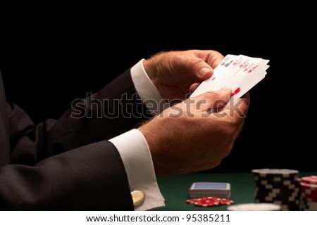 poker player gambling casino chips on green felt background selective focus