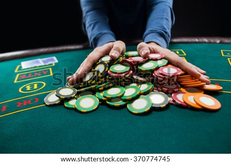 Poker player going all-in pushing his chips forward ストックフォト ©
