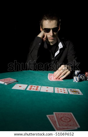 Poker player looking at his hand