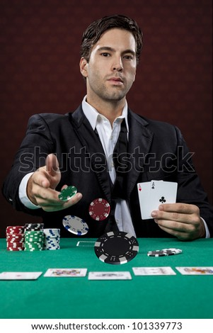 Poker player, on a red background, throwing poker chips.