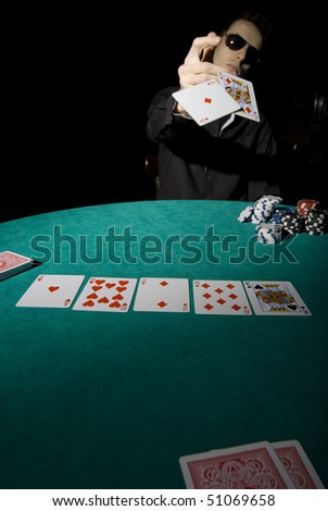 Poker player showing his cards
