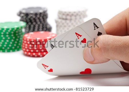 Poker: player shows pocket aces with poker chips in the back on white background