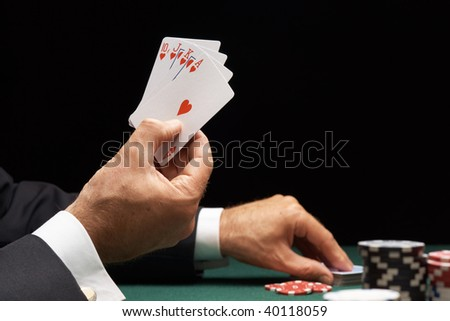 Poker player winning hand of cards royal flush with casino chips