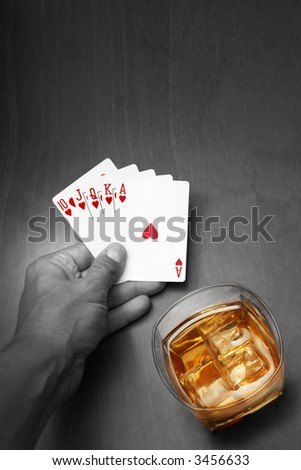 Poker player with cards and whiskey in color.