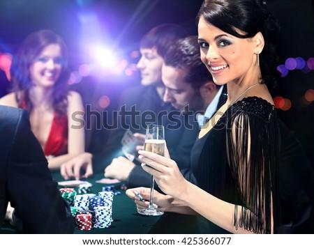 Poker players sitting in casino