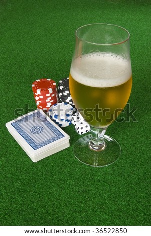Poker table with chips beer dices and cards