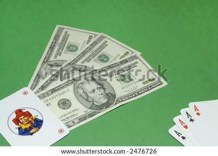 Poker with jolly and dollar bills on a casino table background