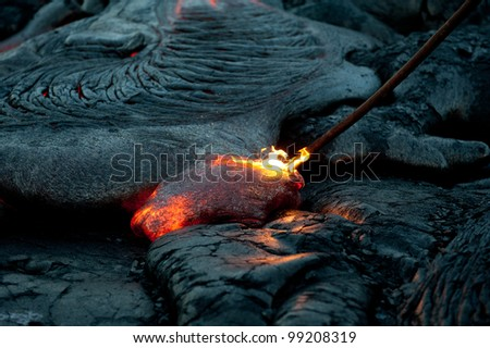 Poking Lava at Hawaii Volcano National Park