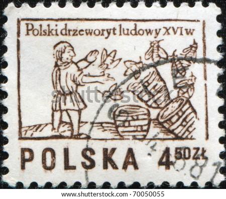POLAND - CIRCA 1963: A stamp printed in Poland shows beekeeper, circa 1963 - stock photo