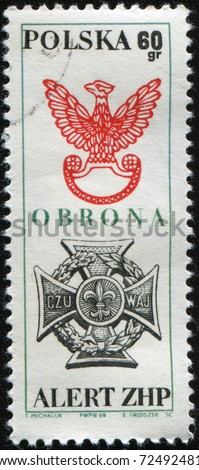 POLAND - CIRCA 1969: A stamp printed in Poland shows Eagle Scouts and Youth Movements Badges, honoring 5th National Alert of Polish Boy Scout Association, circa 1969