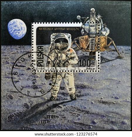 """POLAND - CIRCA 1989: A stamp printed in Poland shows Neil Armstrong, lunar module """"Eagle"""" from Apollo 11, circa 1989"""