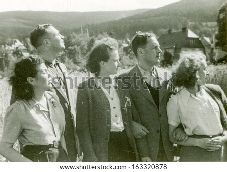 POLAND, CIRCA FIFTIES -  unidentified young women and men posing outside in mountains - in Poland, circa fifties