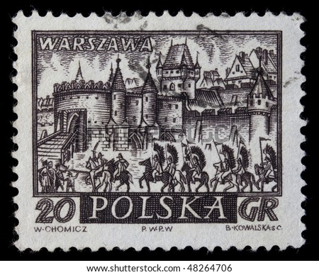 POLAND, CIRCA 1960 - medieval town of Warsaw, Polish capitol,  with hussar winged cavalry on a vintage, canceled post stamp, dark brown engraving on white circa 1960