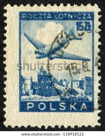 POLAND - CIRCA 1946: Postage stamp printed in Poland (Polish Peoples Republic) shows Douglas Plane over Ruins of Warsaw. Scott catalog C15 AP3 15zt, blue, circa 1946