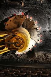 Poland coal mine interior - underground tunnel. Industry in Zabrze, Upper Silesia. Longwall mining shearer machine.