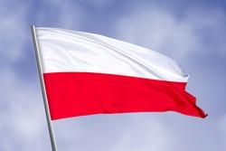 Poland flag isolated on sky background. close up waving flag of Poland. flag symbols of Poland.