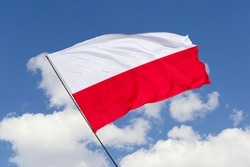Poland flag isolated on sky background with clipping path. close up waving flag of Poland. flag symbols of Poland.