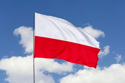 Poland flag isolated on the blue sky with clipping path. close up waving flag of Poland. flag symbols of Poland.
