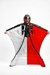 Poland flag travel. Bird Men in wing suit flag. Sky diving men in parashute. Patriotism, men and flag.