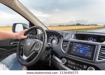 POLAND - July 13, 2018: Man driving Honda CR-V. #1136406575