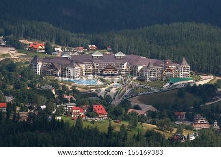 POLAND, KARPACZ - AUGUST 2011: Golebiewski Hotel in Karpacz, the biggest hotel in Karpacz in Karkonosze Mountains, view from Sniezka Mountain. August 03, 2011