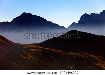 Poland, Tatra Mountains, Zakopane - Szczyrbski Szczyt and Cichy Wierch peaks, Wierchcicha Valley with High Tatra in background Zdjęcia stock ©