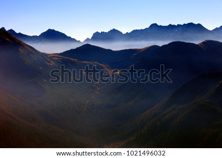 Poland, Tatra Mountains, Zakopane - Wierchcicha Valley and Cichy Wierch, Zadnia Garajowa Kopa peaks with High Tatra in background Zdjęcia stock ©