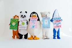 Polar bear and animal mascots characters with a message for humanity, about global warming and pollution problems on our planet