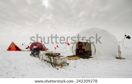 Polar research dive camp over a drifting ice floe in Antarctica