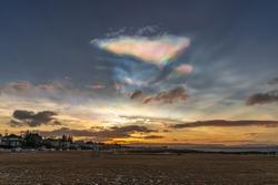 Polar stratospheric clouds and sunrise. Nacreous clouds. Rainbow clouds and the Atlantic Ocean coast