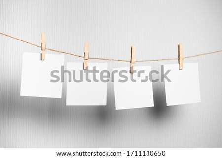 polaroid frame.Retro photo frames hanging on rope isolated on white background. real photo. four frames