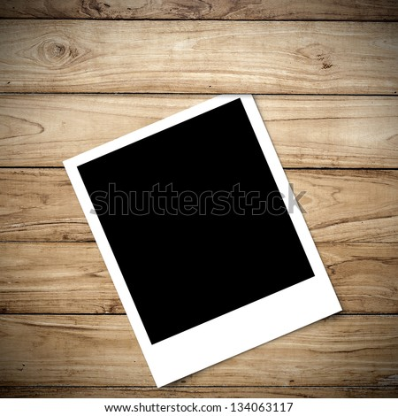 Polaroid on Big Brown wood plank wall texture background