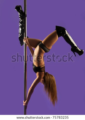 pole dancer making stretching figure