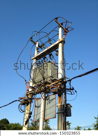 pole type electrical transformer on blue sky background