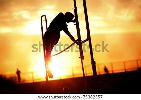 Pole vaulter at sunset