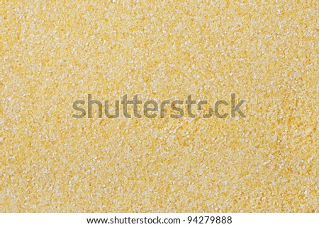 Polenta, or cornmeal filling full frame for texture or background