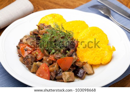 Polenta slices with vegetable stew