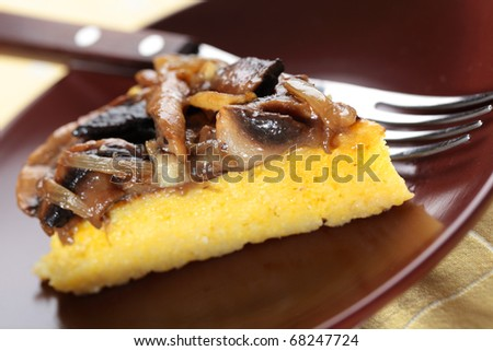 Polenta with mushrooms and onion closeup