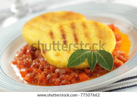 Polenta with salsa on the plate