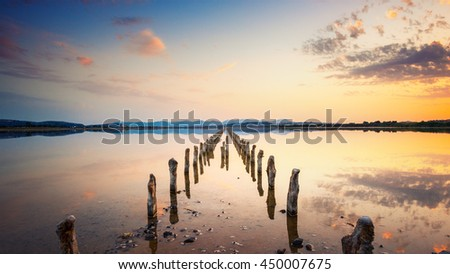 stock photo poles in perspective on the pond at sunset in a perfect calm day calmness and silence concept 450007675 - Каталог - 3d фотообои