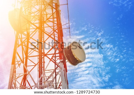 Poles telecom tower with clouds and blue sky.