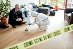 Police and Forensics work together at crime scene for a crime